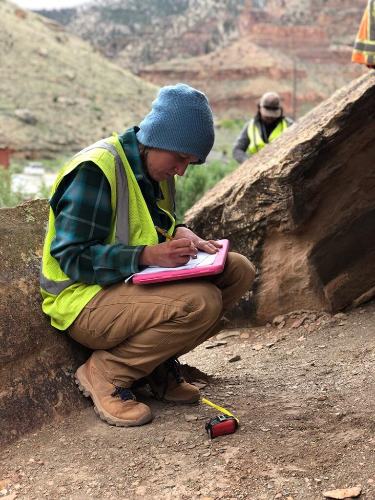 Member of PaleoWest's team taking measurements while at the canyon site